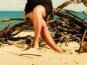 Woman legs on beach.