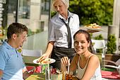 Waitress bring couple lunch food restaurant terrace