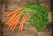 Carrots on rustic wooden background. Country style food concept