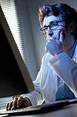 Researcher working at computer