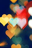 Blurred valentine background with heart-shaped highlights.