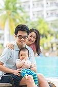 Attractive Asian Family Outdoor Lifestyle on a pool