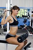 The woman on a training apparatus in sports club