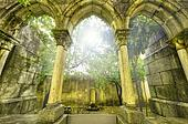 Ancient gothic arches in the myst. Fantasy landscape in Evora, Portugal.