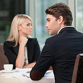 Couple of businesspeople looking in different sides. Disagreement and misunderstanding in communication.