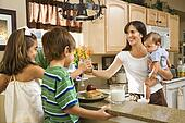 Family in kitchen with breakfast